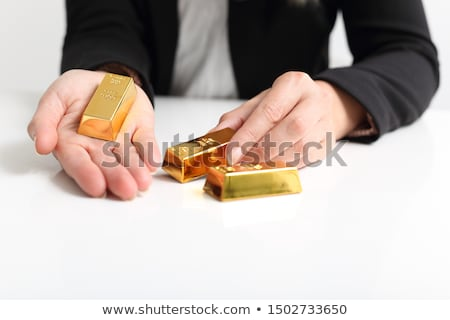 Businessman holding out a gold bar Stock photo © AndreyPopov