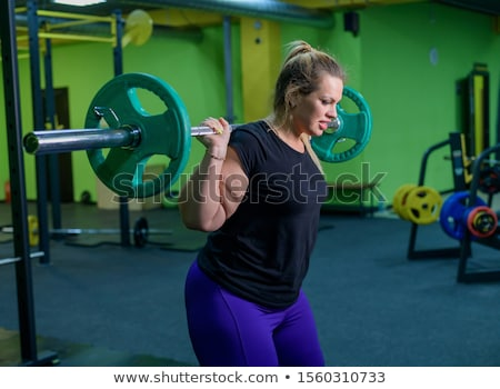 Fat woman does fitness with dumbbell Stock photo © Witthaya