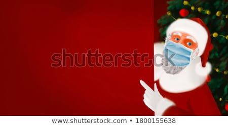 Santa claus in christmas suit Stock photo © LoopAll