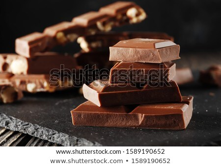 Chocolate peças mesa de madeira Foto stock © feelphotoart