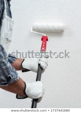 Homem pintar branco pintura masculino Foto stock © wavebreak_media