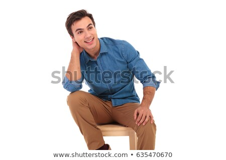side view of  seated young man holding hands behind head Stock photo © feedough