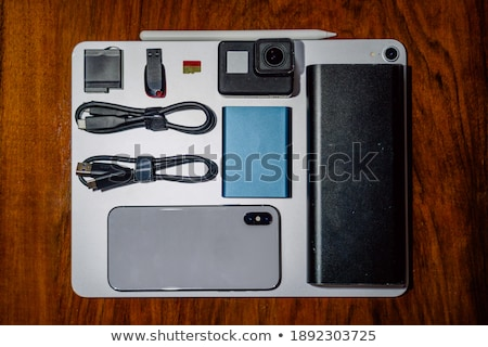 Various electronic gadgets on wooden surface Stock photo © wavebreak_media