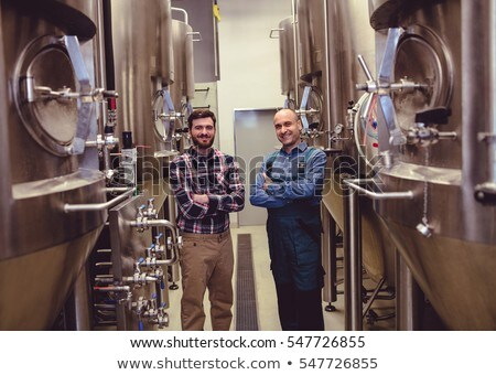 Confident manufacturer standing in brewery Stock photo © wavebreak_media