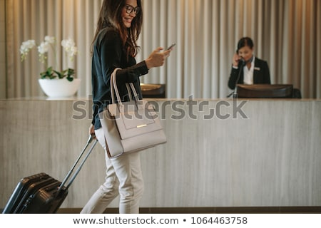 Women arriving at hotel with suitcases Stock photo © IS2