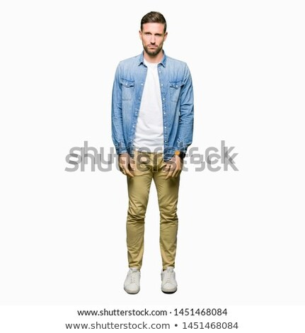 portrait of a sad young casual man standing stock photo © deandrobot