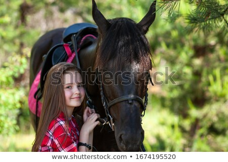 beautiful and natural adult woman outdoors with horse child stock photo © lopolo