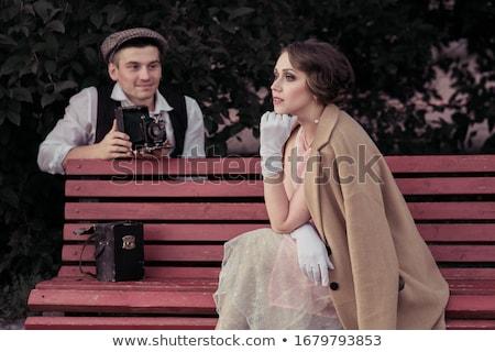 笑みを浮かべて 男 コート 座って 通り ラップトップを使用して ストックフォト © deandrobot