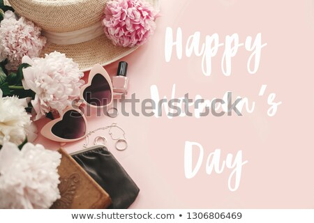 woman with a pink hat and the text womens day stock photo © nito