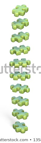 Collection of green puzzle jigsaw pieces rotated 3D Stock photo © djmilic