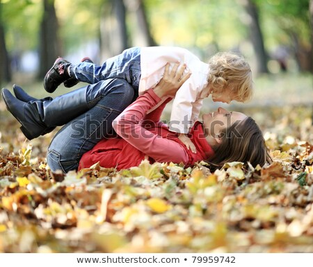 happy family having fun on beautiful autumn day stock photo © lopolo