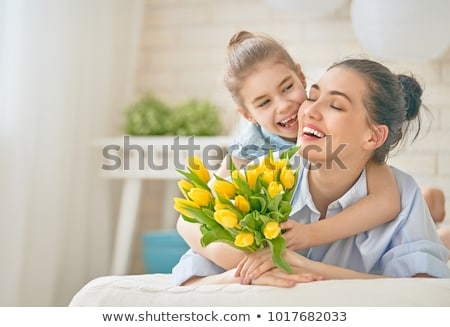 mother and her daughter hugging on bed stock photo © andreypopov