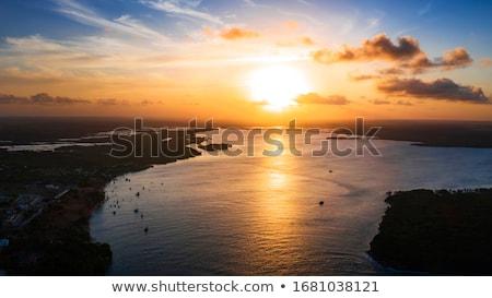 Tan gün batımı plaj güzel bulutlar gökyüzü Stok fotoğraf © 3523studio