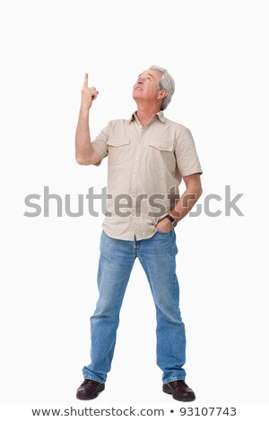 Mature male looking and pointing up against a white background Stock photo © wavebreak_media