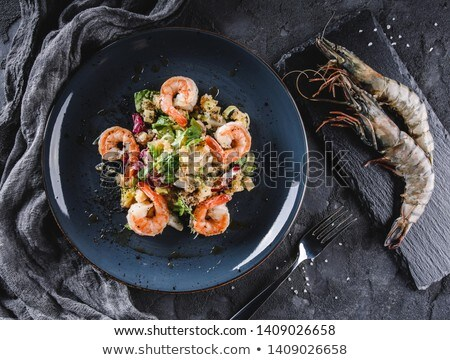 shrimp on fork over a mix food background Stock photo © dacasdo