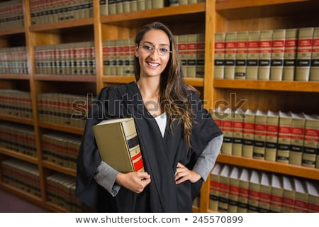 Young lawyer with the law book looks  Stock photo © Farina6000