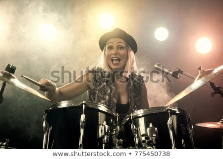 Woman playing the dumrs Stock photo © deandrobot