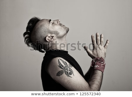 man with mohawk and tattoos stock photo © iofoto