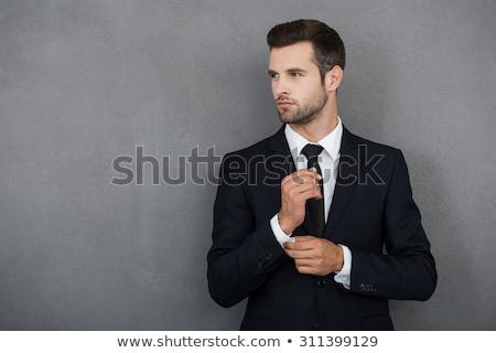 Dalgın adam takım elbise genç portre Stok fotoğraf © filipw
