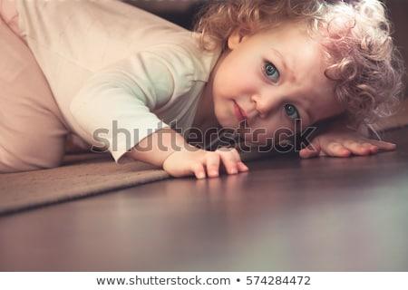 Portrait of cute girl playing under shelter Stock photo © wavebreak_media