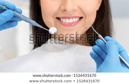 Orvosi fogorvosi rendelő fiatalember fiatal női orvos Stock fotó © boggy