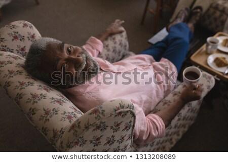 glimlachend · man · koffie · buiten · coffeeshop · water - stockfoto © wavebreak_media