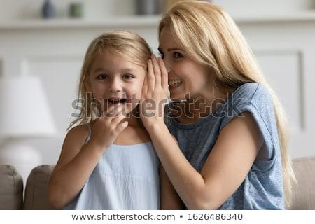 Fille chuchotement secret mère maison confiance Photo stock © dolgachov