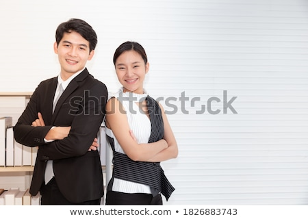 Close up of smiling female entrepreneur against a white background Stock photo © wavebreak_media
