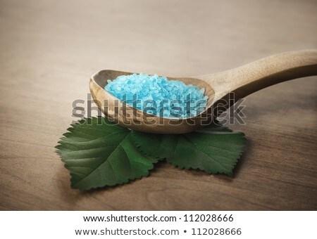 blue bath salt in wooden spoon stock photo © jirkaejc