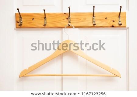 Kleding opknoping deur jas ander ontwerp Stockfoto © tepic