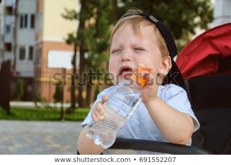 少年 座って 乳母車 飲料水 子 男の子 ストックフォト © bmonteny
