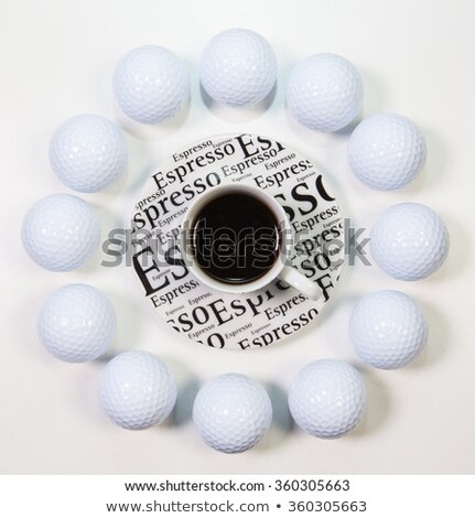 Circle of golf balls and a cup of coffee Stock photo © CaptureLight