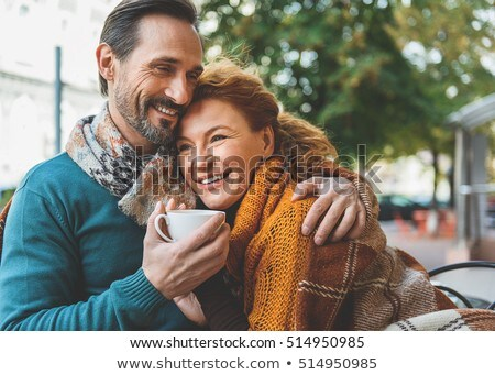 two happy women hugging in cafe stock photo © deandrobot