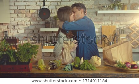 Mature couple unpacking bags in room Stock photo © IS2