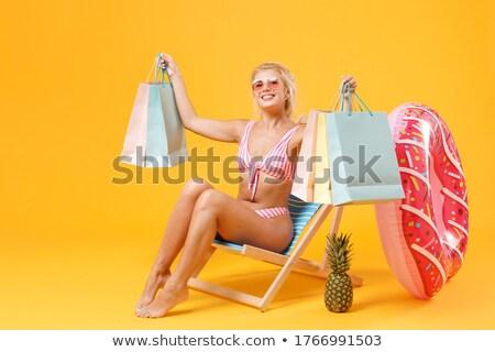 Frau Badebekleidung halten Einkaufstaschen Foto glücklich Stock foto © deandrobot