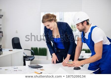 Férfi női munkások technikai tervrajzok beszél Stock fotó © feverpitch