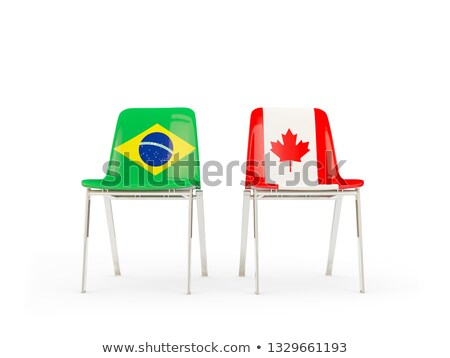 Foto stock: Two Chairs With Flags Of Canada And Brazil Isolated On White