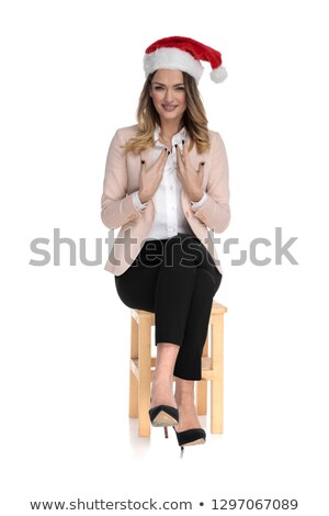 happy businesswoman wearing santa hat sits on wooden chair  Stock photo © feedough