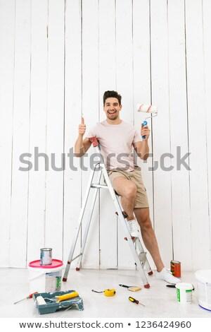 Tam uzunlukta fotoğraf esmer adam 20s ayakta Stok fotoğraf © deandrobot