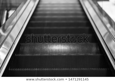 Escalator technologie transport aéroport escaliers Photo stock © dolgachov