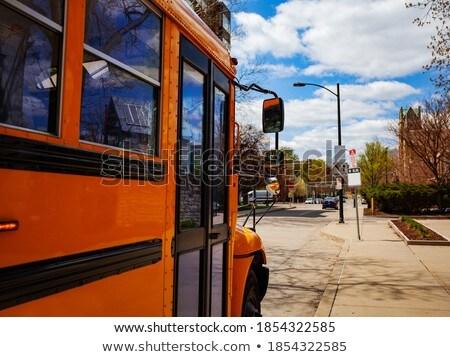 close up of american schoolbus on city street Stock photo © dolgachov