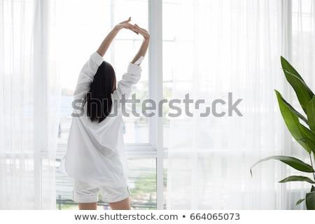 красивой азиатских женщину расслабляющая домой подушкой Сток-фото © Maridav