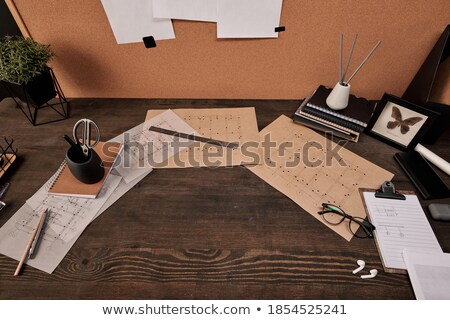 Architect in office surrounded by plans Stock photo © photography33