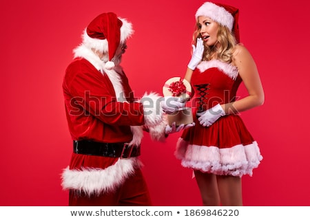 smiling young woman at christmastime in red clothes isolated stock photo © juniart