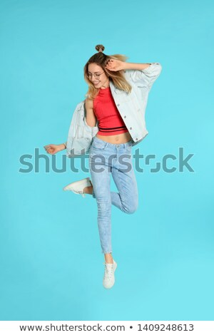 Pretty model in trendy outfit, full length portrait Stock photo © stockyimages
