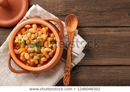 Pinto beans in a green bowl Stock photo © raphotos