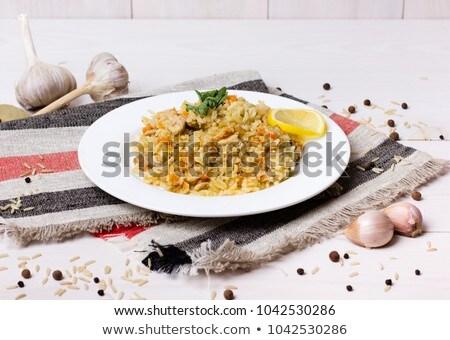 Plov in plate Stock photo © TasiPas
