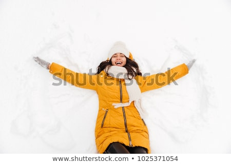 Woman laughing,  lying in snow Stock photo © IS2