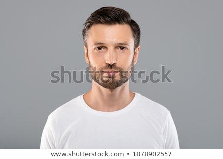 uśmiechnięty · człowiek · patrząc · portret · młodych - zdjęcia stock © is2