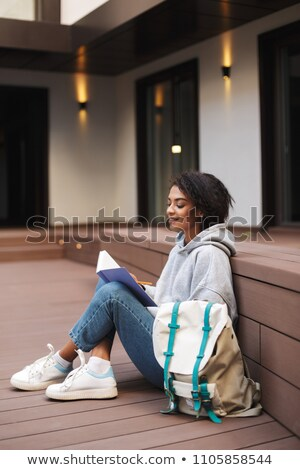 Portrait of a dreamy young girl with backpack Stock photo © deandrobot